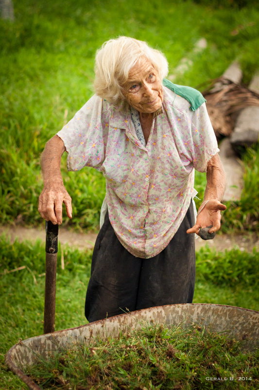 Dr. Lyn (Grandma) weeding the hospital property. 89 and going strong!